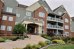 GREAT 2 STORY CONDO BACKING THE ROYAL OAKS GOLF COURSE!!