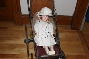 GERMAN BISQUE DOLL & DOLL CARRIAGE FROM TURN OF THE 18TH CENTURY