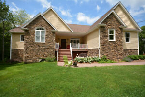 EXQUISITE CUSTOM BUNGALOW ON 2.8 ACRES NESTLED IN THE WOODS
