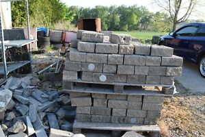 Used paving stone and used wall wedge stones