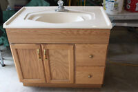 Oak vanity with one piece molded sink/counter top