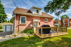 HOUSE FOR SALE - All updated brick bungalow with Dry Basement!!