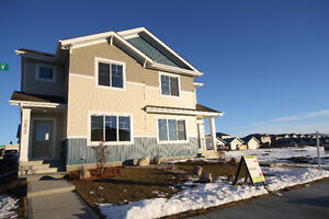 Beautiful duplex in Laurel Greens! BRAND NEW! Double Garage!