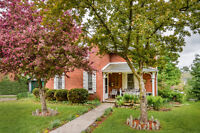 Charming Red Brick Century Home on a Park-Like Lot