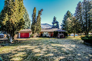 Riverfront Home on Nearly 1/2 Acre w/ River and Mountain Views