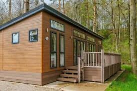 Luxury lodge chalet holiday home for sale over looking river views lake district