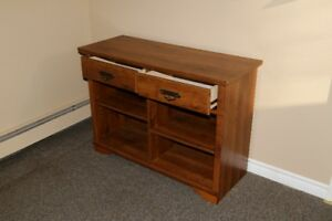 Cabinet with 2 drawers and shelves.