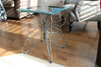 2 butterfly glass top end tables.