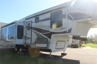 2009 Titanium 5th wheel model 32-37 RSA $37500. OBRO
