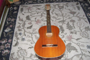 FIVE STRING ACOUSTIC GUITAR IN PLAYING ORDER NEEDS SOME TLC.