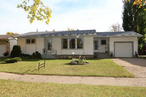 Check out this 1078sqft bungalow, complete w/ an attached garage Regina Regina Area image 1