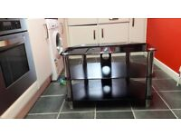 Black Glass tv unit with chrome legs ,prob suit 32 inch,great condition
