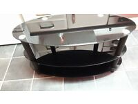black Glass tv unit,oval shape ,reccomend for 32 inch great condition