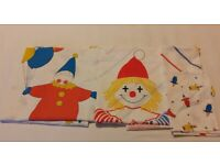 Two 'Circus Clown' themed cot size duvet covers with pillow cases.