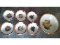 Porcelain set of bowls made in 1792. A porcelain tea set and tray, and bull China bells