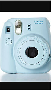 Blue Instax camera for sale + new package of film