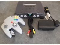 NINTENDO 64 with 2 controllers and leads and a boxed super mario.