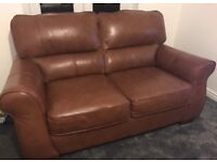 Large 2 seated real leather brown sofa