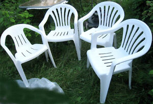 4 (3+1) white plastic Patio Chairs, 3-the same & 1-similar style
