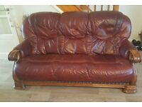 2 leather sofas and a solid wooden table