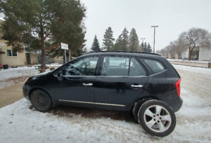 2008 Kia Rondo EX w/3rd Row - Luxury SUV - Reduced price