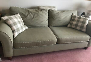 Free sage green couch in good condition.