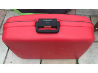 Red Constellation hard suitcase. Used once Telescopic handle and wheels