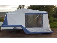 Combi Camp Easy trailer tent with under floor storage side extension kitchen and awning.