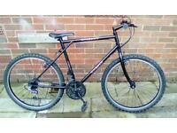 """18 speed mountain bike , 26"""" wheels , matte black"""