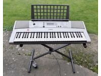 Yamaha electronic keyboard PSR-e313 with 61 keys, stand, book rest and 5 music books