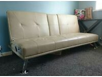 Faux leather sofa bed with Bluetooth speaker