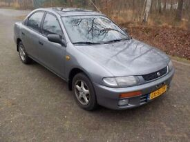 LEFT HAND DRIVE MAZDA 323, RUNS SMOOTHLY, ENGINE AND GENERAL MECHANICS IN GOOD CONDITION...CALL ME