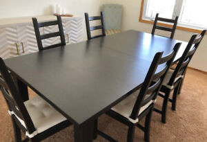Solid wood dining room table sits 14 people. 2 extension leaves