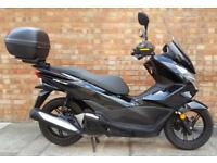 Honda PCX 125cc. Good condition with large screen and knuckle guard