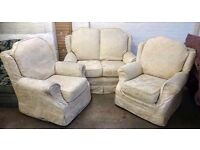 Cream fabric three piece suite - two seater sofa 135cm and two chairs