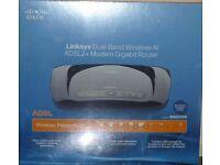 Brand new Cisco, Linksys Dual-Band WAG320N ADSL2+ Modem Gigabit Wireless N Router