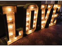 Rustic wooden light up LOVE letters for hire