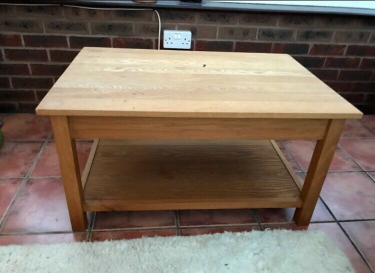 Solid Oak coffee table with a shelf