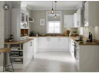 Brand new slab white kitchens