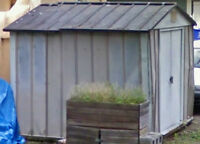 Metal shed w/ plywood fl & supporting timber & bricks
