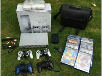 VGC PS2 bundle includes console, carry bag, 10 games and 4 controllers