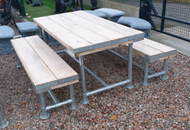 Very heavy duty wooden picnic table made from scaffolding bars planks