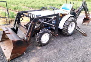 4x4 diesel tractor with front end loader and backhoe