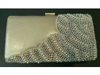 New silver and gold clutch bag for sale