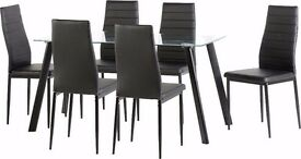 Lovely BRAND NEW metal and glass dining table with 6 faux leather chairs.can deliver