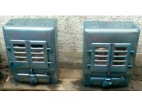 A PAIR OF 1930'S ENAMELLED COURTIER, MULTI FUEL STOVES.