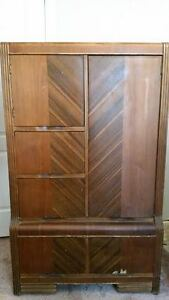 Antique armoir enclosed shelves and drawers