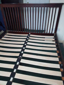 Mahogany coloured double bed frame