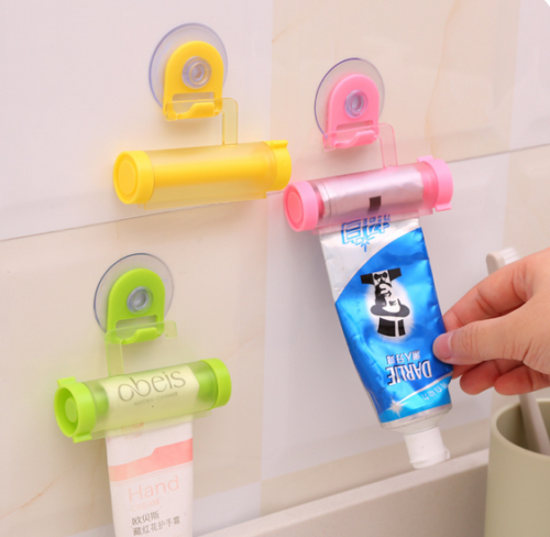 Plastic Rolling Toothpaste Tube Squeezer Dispenser Holder Sucker Hanging Cute d6