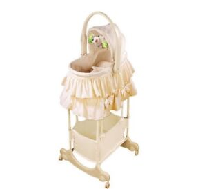 Bassinet with change table sings vibrates